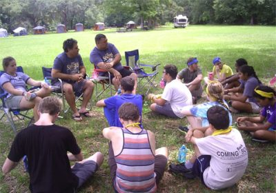 Teens and retreat leaders sitting and talking
